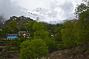The Greater Himalayan Range right above Kamru village of Sangla valley right after a fresh rainfall in the region.