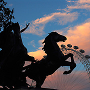 Queen Boadicea statue with The London Eye ferris wheel at sunset, London, England, UK<br />