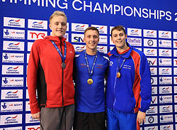 The medal ceremony for the Men's 1500m Freestyle gold medalist Daniel Jervis (centre) silver medalist Timothy Shuttleworth (left) and bronze medalist Stephen Milne during day three of the 2017 British Swimming Championships at Ponds Forge, Sheffield.