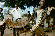 Village life in Africa: Musicians of Bobo tribe playing drums and balafon xylophone in Koumbia, Burkina Faso, Africa.