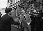 Clement Coughlan New Fianna Fáil TD.  (N50)..1989..11.11.1980..11th November 1980..The new Fianna Fáil TD for Donegal, Mr Clement Coughlan TD took his seat at Dáil Éireann, Leinster House today..Picture shows Mr Sean Moore TD, Fianna Fáil,Chief Whip welcoming Mr Clement Coughlan TD to Dáil Éireann.Other Fianna Fáil TDs are in the background.