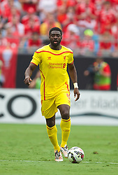 CHARLOTTE, USA - Saturday, August 2, 2014: Liverpool's Kolo Toure in action against AC Milan during the International Champions Cup Group B match at the Bank of America Stadium on day thirteen of the club's USA Tour. (Pic by David Rawcliffe/Propaganda)