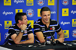 New arrival and rugby league convert Sam Burgess looks on, alongside Head Coach Mike Ford, during a Bath Rugby press conference at the Recreation Ground - Photo mandatory by-line: Patrick Khachfe/JMP - Mobile: 07966 386802 30/10/2014 - SPORT - RUGBY UNION - Bath - The Recreation Ground - Bath Rugby Photocall with Sam Bugess