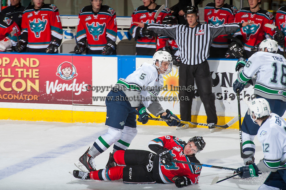 KELOWNA, CANADA - DECEMBER 7: Jarret Tyszka #5 of the Seattle Thunderbirds checks Dillon Dube #19 of the Kelowna Rockets on December 7, 2016 at Prospera Place in Kelowna, British Columbia, Canada.  (Photo by Marissa Baecker/Shoot the Breeze)  *** Local Caption ***