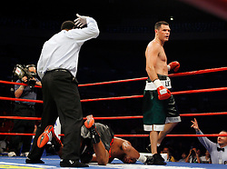 October 6, 2007; New York, NY, USA; Kali Meehan (green trunks) knocks out DaVarryl Williamson (black trunks) in the sixth round of their bout at Madison Square Garden.
