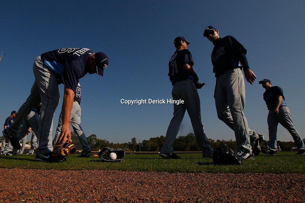 February 20, 2011; Port Charlotte, FL, USA; Tampa Bay Rays relief pitcher Adam Russell (36) picks up his glove during spring training at Charlotte Sports Park.  Mandatory Credit: Derick E. Hingle