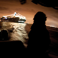 "Mark Allen White, Supervisory Marine Interdiction Agent with Customs and Border Protection, .San Diego Air & Marine Branch, patrols the waters near the US/Mexico border for undocumented immigrants in the early morning hours. The unit is also on patrol for gun smugglers hauling firearms into Mexico which is helping to fuel the Narco wars raging in Mexico. For more images, search for ""immigration by air and sea"". Please contact Todd Bigelow directly with your licensing requests."