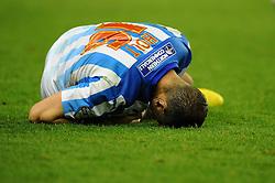 Huddersfield Town's Grant Holt goes down injured - Photo mandatory by-line: Dougie Allward/JMP - Mobile: 07966 386802 - 01/10/2014 - SPORT - Football - Wolverhampton - Molineux Stadium - Wolverhampton Wonderers v Huddersfield Town - Sky Bet Championship