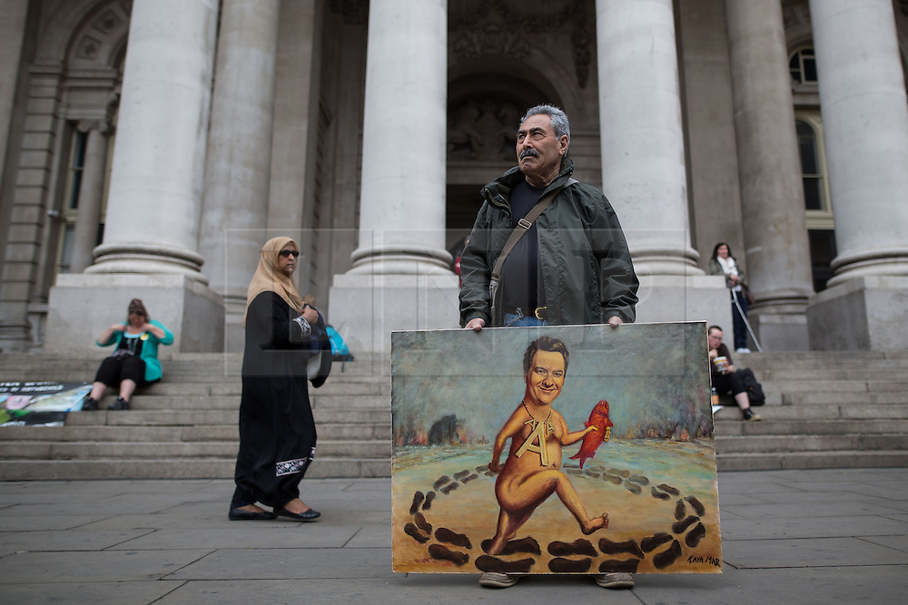 © Licensed to London News Pictures . 20/06/2015 . London , UK . Artist Kaya Mar carrying a piece featuring Chancellor George Osborne , opposite the Bank of England . Tens of thousands of people march from the Bank of England to Parliament , to protest economic austerity in Britain . Photo credit: Joel Goodman/LNP