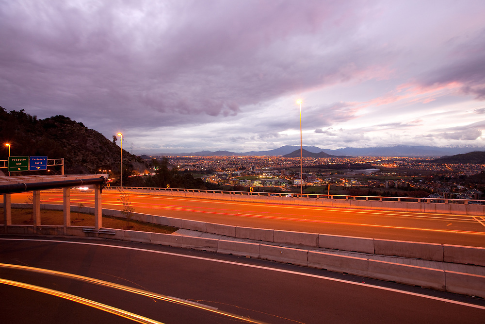 Freeway and panoramic view of western side of the city, Vitacura, Santiago, Chile
