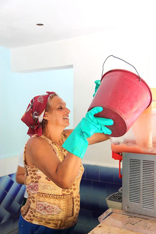 Pouring juice at El Tropico in Holguin, Cuba.