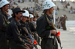 KABUL,AFGHANISTAN - SEPT. 2: An Afghan police officer gurads the stadium where President Hamid Karzai, together with representatives of the Ministry of Public Health, WHO and UNICEF kicked off a three-day nation wide immunisation campaign against polio September 2, 2002 in Kabul, Afghanistan.  The latest campaign will target 5.9 million children under the age of five and teams of vaccinators will go from village to village to ensure that all children in that age bracket are immunised. President Karzai adminstered the first drops of the Oral Polio Vaccine to an unidentifies Afghan child. (Photo by Ami Vitale/Getty Images)