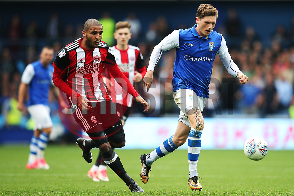 Adam Reach of Sheffield Wednesday takes on Leon Clarke of Sheffield United - Mandatory by-line:  Matt McNulty/JMP - 24/09/2017 - FOOTBALL - Hillsborough - Sheffield, England - Sheffield Wednesday v Sheffield United - Sky Bet Championship