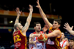 Tornike Shengelia of Georgia between Pero Antic and Predrag Samardziski of Macedonia during basketball game between National basketball teams of  Georgia and Former Yugoslav Republic of Macedonia at FIBA Europe Eurobasket Lithuania 2011, on September 8, 2011, in Siemens Arena,  Vilnius, Lithuania. (Photo by Vid Ponikvar / Sportida)