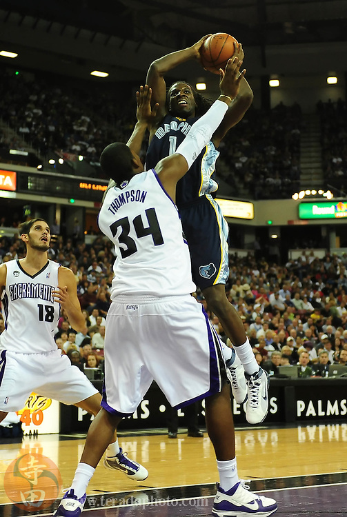 November 2, 2009; Sacramento, CA, USA; Memphis Grizzlies forward DeMarre Carroll (1) shoots over Sacramento Kings forward Jason Thompson (34) during the second quarter at Arco Arena. The Kings defeated the Grizzlies 127-116 in overtime. Mandatory Credit: Kyle Terada-Terada Photo