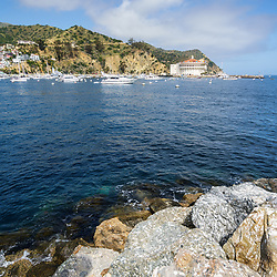 Catalina Island Casino with Avalon Harbor and breakwall rocks photo. Beautiful Santa Catalina Island is a popular travel destination off the Southern California coast. Photo is high resolution. Copyright ⓒ 2017 Paul Velgos with All Rights Reserved.