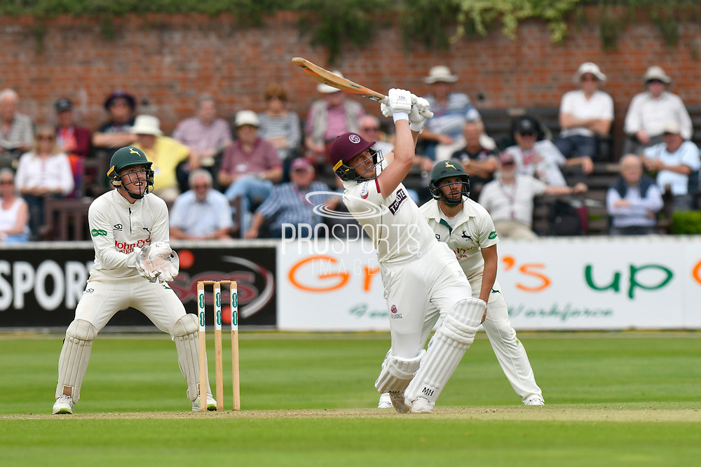 Josh Davey of Somerset hits the ball over the boundary for six runs during the Specsavers County Champ Div 1 match between Somerset County Cricket Club and Nottinghamshire County Cricket Club at the Cooper Associates County Ground, Taunton, United Kingdom on 10 June 2018. Picture by Graham Hunt.