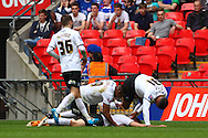 Shaun Brisley of Peterborough United (on floor) celebrates scoring his team's second goal with team mates during the Johnstone's Paint Trophy Final match at Wembley Stadium, London<br /> Picture by David Horn/Focus Images Ltd +44 7545 970036<br /> 30/03/2014