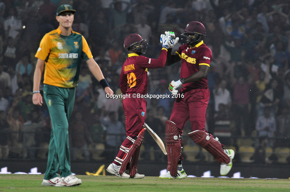 West Indies players celebrating wining against South Africa by 3 wickets during the 2016 ICC World T20 cricket match between South Africa and West Indies at Vidharbha Cricket Association, Jamtha, India on 25 March 2016 ©BackpagePix