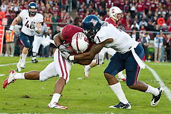 November 6, 2010; Stanford, CA, USA;  Stanford Cardinal wide receiver Doug Baldwin (89) is tackled by Arizona Wildcats cornerback Robert Golden (1) during the first quarter at Stanford Stadium.