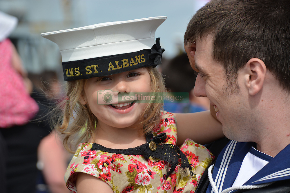 Leading Seaman Stuart Donnelly, 30, from St Helens, Merseyside, is welcomed home by Olivia, 4, as HMS St Albans arrives at Portsmouth Naval Base following a nine-month deployment to the Middle East.