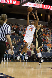 Virginia's Monica Wright (22) heads to the basket around Wake's Alex Tchangoue (2). The Cavaliers defeated the Demon Deacon 77-71 on January 11, 2007 for their first ACC win in the John Paul Jones Arena in Charlottesville, VA.<br />