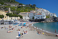 Beach, Amalfi, Italy. Sunbathers enjoy a sunny may day