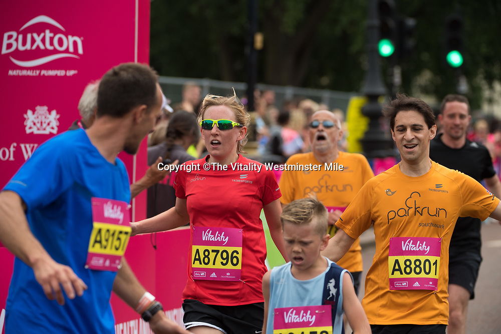 Ellie Awford and Mike Krotosky set a Guinness World Record for the fastest Road Mile run holding hands at the finishing line outside Buckingham Palace at The Vitality Westminster Mile, Sunday 28th May 2017.<br /> <br /> Photo: Thomas Lovelock for The Vitality Westminster Mile<br /> <br /> For further information: media@londonmarathonevents.co.uk