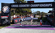 Dec 8, 2018; Balboa Park, CA, USA; Cole Hocker of Cathedral High (Ind.) celebrates after winning the boys race in 15:13.7, breaking the finish line tape held by Brenda Martinez (left) and Emily Infeld,  during the 40th Foot Locker cross country championships at Morley Field.