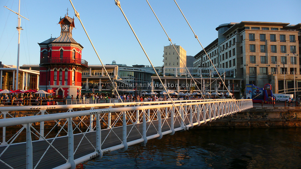 View across the swinging bridge of the clock tower, a tourist attraction in the Victoria and Alfred Waterfront. Cape Town, South Africa. Cape town is South Africa's most visited destination.