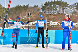 DAVIET Benjamin FRA LW2, REPTYUKH Ihor UKR LW8, OLSRUD Hakon NOR LW8 competing in the ParaSkiDeFond, Para Nordic Skiing, 20km at  the PyeongChang2018 Winter Paralympic Games, South Korea.
