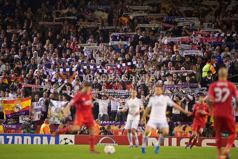 LIVERPOOL, ENGLAND - Wednesday, October 22, 2014: Real Madrid CF supporters celebrate as their side beat Liverpool 3-0 during the UEFA Champions League Group B match at Anfield. (Pic by David Rawcliffe/Propaganda)