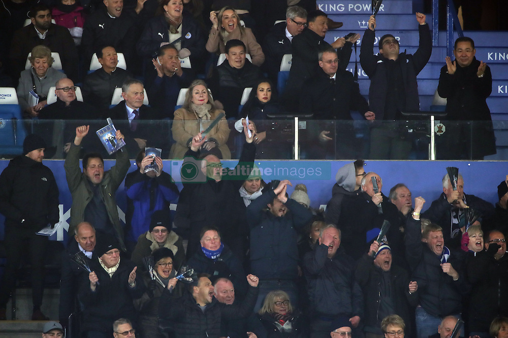Leicester City vice-chairman Aiyawatt Srivaddhanaprabha and chairman Vichai Srivaddhanaprabha (top right) celebrate after the Premier League match at the King Power Stadium, Leicester.