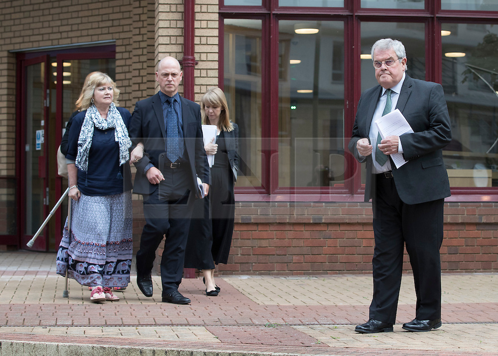 """© Licensed to London News Pictures. 03/06/2016. Woking, UK.  Doreen James (L) and Des James (R) leave Woking Coroner's Court. A second inquest into the death of army recruit Private Cheryl James has announced its verdict today. Coroner Brian Barker QC has ruled the death of Private James was caused by a """"self-inflicted"""" wound. Cheryl was found dead with a bullet wound to her head in November 1995.  Aged just 18 she was one of four young soldiers who died at the Deepcut Barracks in Surrey between 1995 and 2002, amid claims of bullying and abuse. Photo credit: Peter Macdiarmid/LNP"""