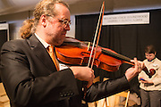 "Pieter Affourtit plays with one of his snakewood baroque-style bows with a ""pike"" or ""swan-bill"" head."