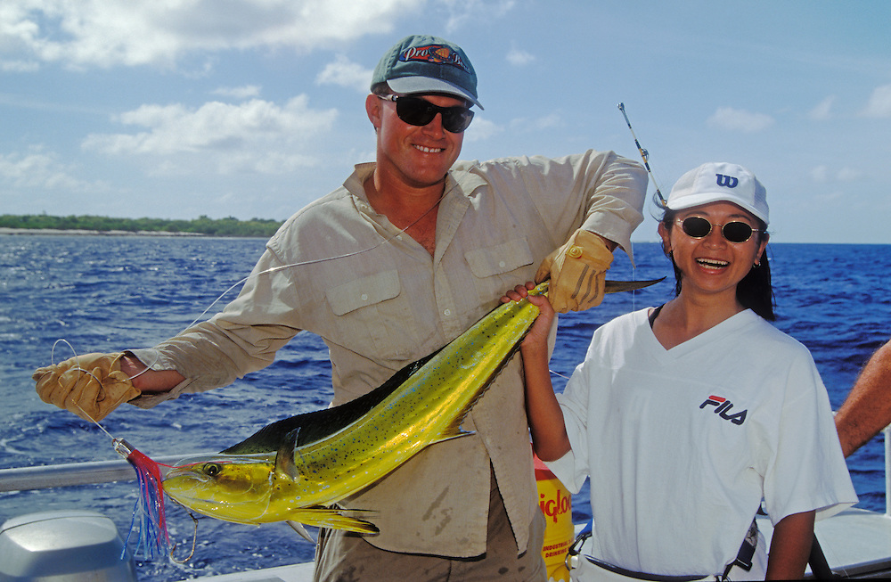 Marshall Islands, Micronesia: Fishing Guide Rod Bourke and Japanese visitor Yuki Nakako with Mahimahi caught at Bikini Atoll.