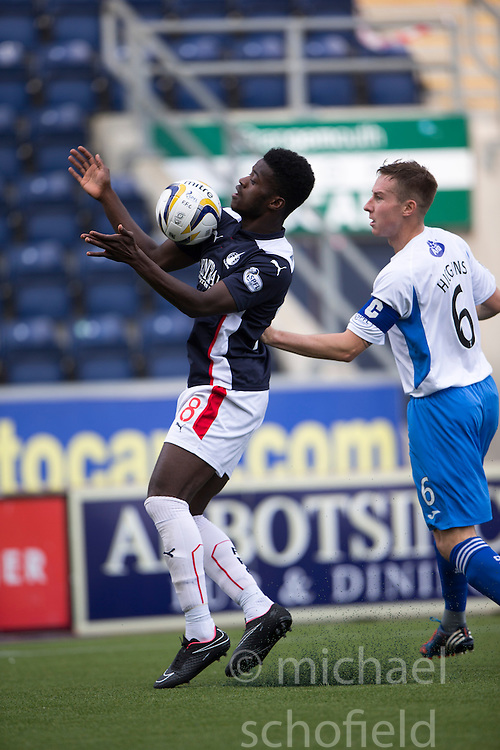 Falkirk's Botti Biabi and Queen of the South's Chris Higgins.<br /> Half time : Falkirk 0 v 0 Queen of the South, Scottish Championship game played today at The Falkirk Stadium.