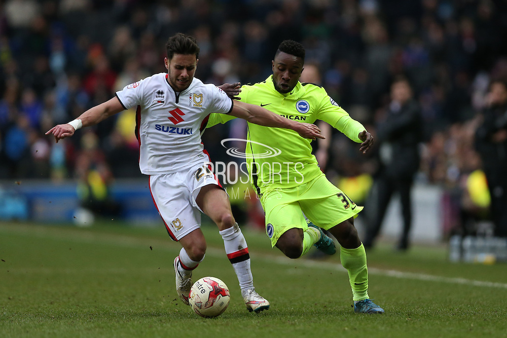 Milton Keynes Dons defender George Baldock (21) and Brighton midfielder, winger, Kazenga LuaLua (30) during the Sky Bet Championship match between Milton Keynes Dons and Brighton and Hove Albion at stadium:mk, Milton Keynes, England on 19 March 2016.
