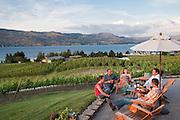 A group of winemakers enjoys an evening BBQ at Nefarious Cellars and Vineyards overlooking Lake Chelan, Washington