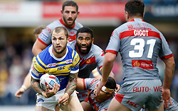 Leeds Rhinos' Luke Briscoe skips away from Catalans Dragons' Samisoni Langi, David Mead and Catalans Dragons, during the Betfred Super League match at Emerald Headingley Stadium, Leeds.