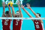 Russia's Dmitriy Ilinykh and Nikolay Apalikov and Sergey Savin (right) defend while volleyball match between Brazil and Russia during the 2014 FIVB Volleyball World Championships at Spodek Hall in Katowice on September 14, 2014.<br /> <br /> Poland, Katowice, September 14, 2014<br /> <br /> For editorial use only. Any commercial or promotional use requires permission.<br /> <br /> Mandatory credit:<br /> Photo by © Adam Nurkiewicz / Mediasport