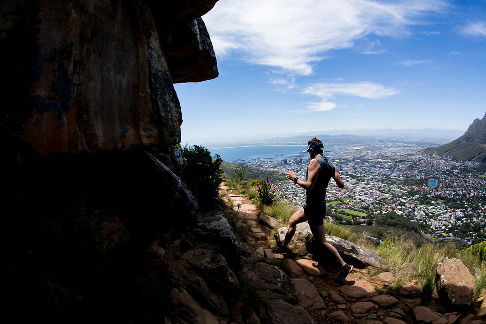 A competitor negotiates the rocks during the Red Bull Lion Heart, on Lions Head, Cape Town, South Africa, 9 November 2013