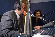 Journalists (from l.) Fabio Poletti and Cecilia Dilieto, during a broadcast in the studio of Radio Popolare in Stradella street, Milan, 1992. Radio Popolare is an Italian free and indipendent radio station; its programs are broadcasted on FM and streaming and by satellite. &copy; Carlo Cerchioli<br /> <br /> I giornalisti (da sin.) Fabio Poletti, cronista giudiziario e Cecilia Dilieto, durante una trasmissione nello studio di Radio Popolare in via Stradella, Milano, 1992. Radio Popolare, &egrave; una radio di informazione libera e indipendente; i suoi programmi sono trasmessi in FM e streaming e via satellite.