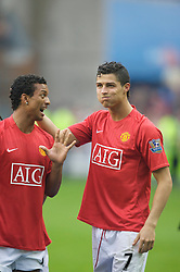 WIGAN, ENGLAND - Sunday, May 11, 2008: Manchester United's Cristiano Ronaldo and Nani celebrate as their side beat Wigan Athletic 2-0 to win the Premier League for the 10th time during the final Premiership match of the season at the JJB Stadium. (Photo by David Rawcliffe/Propaganda)