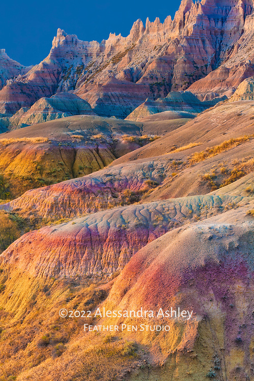 Gold-colored light reveals textures of sand formations at Badlands National Park, South Dakota, USA. Semifinalist, NANPA 2017 Showcase.