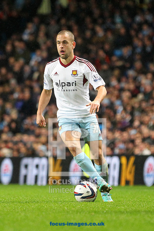 Picture by Paul Chesterton/Focus Images Ltd +44 7904 640267<br /> 08/01/2014<br /> Joe Cole of West Ham in action during the Capital One Cup Semi Final 1st Leg match at the Etihad Stadium, Manchester.