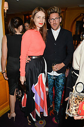 ROKSANDA ILINCIC and HENRY HOLLAND at an exclusive dinner for Iris Apfel held at Annabel's, Berkeley Square, London on 29th July 2015.
