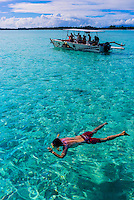 Snorkeling off the island of Bora Bora, Society Islands, French Polynesia.