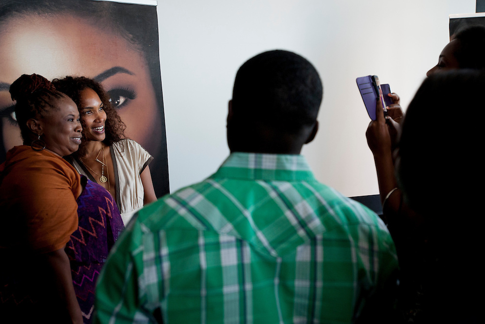 "Mara Brock Akil, creator and executive producer of  BET's ""Being Mary Jane"", poses for photos with guests after a screening at the W Hotel in Dallas, Texas on June 22, 2013."