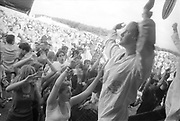 Dancers on stage hyping the crowd, Ashton Court Festival, Bristol, UK, 1995.